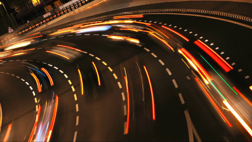 night-high-speed-time-lapse-of-highway-at-night-the-cars-are-moving-upon-the-inclined-road-very-fast-it-is-rush-hour-and-the-car-lights-are-blurred-and-looking-like-bright-lines_4zqd6hcal__F0014.png