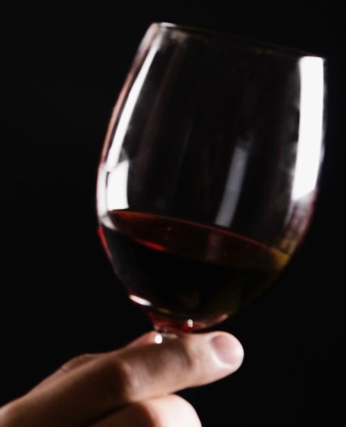 businessman-holding-a-wine-glass-140672303-59558e4f3df78cdc295d1f46 2.jpg