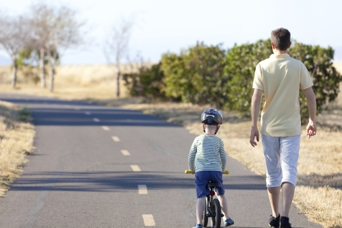 kid-on-bike-with-dad-walking.jpg