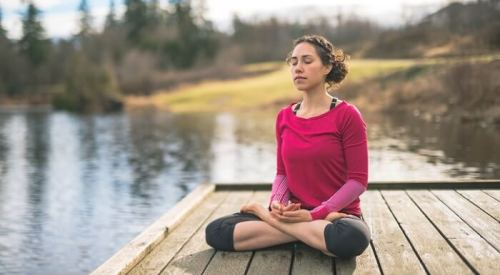 woman-meditating-on-dock.jpg