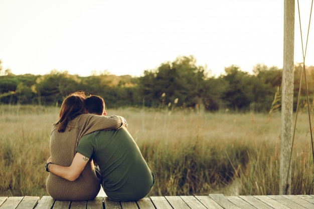 couple-love-embraced-their-backs-reconcile-celebrate-their-love-sitting-nature_47726-5577.jpg