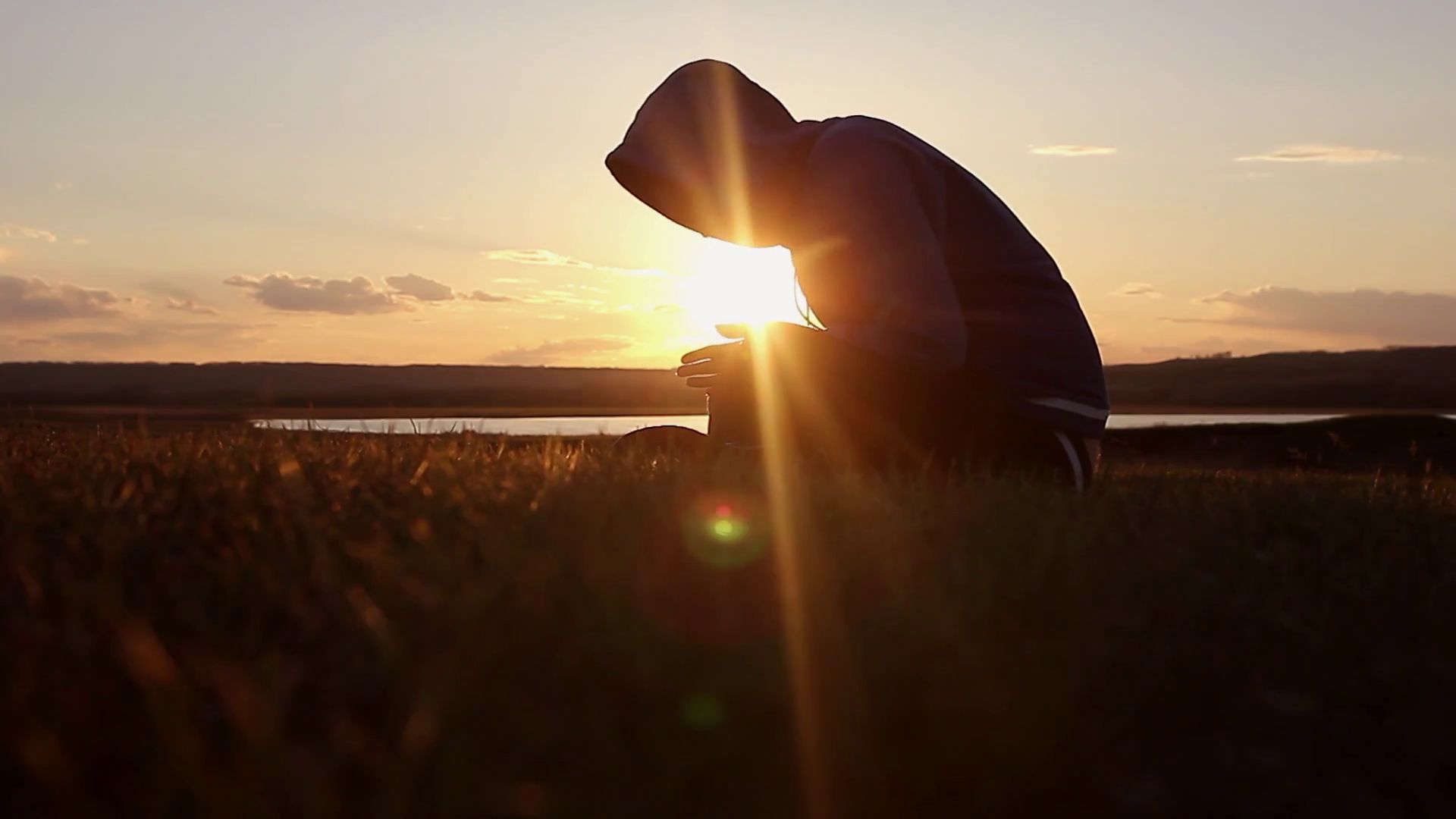 videoblocks-silhouette-of-a-man-praying-at-sunset-concept-of-religion-image-of-silhouette-man-praying-with-sunset-background_hayl7_ccl_thumbnail-full01.png